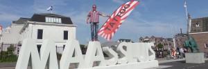 Promotiefoto van Demijnes Tattoo Art en de landmark in Maassluis